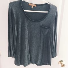 Heather grey cotton top Worn once cotton grey top in very good condition. Three quarter length serves with black leather on the neck outline and pocket. Ellen Tracy Tops