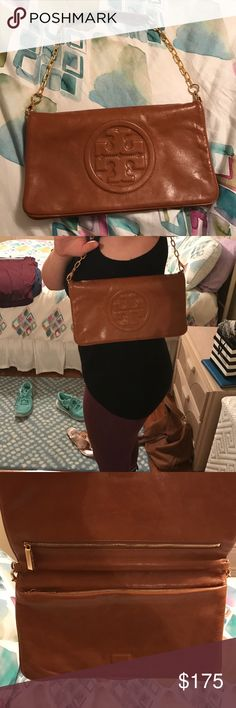 Amazing Tory Burch Fold Over Shoulder Bag This is a classic style in amazing and near perfect condition. It is a gorgeous camel colored leather, with gold chain details. It sits comfortably on the shoulder and has double zippers inside for extra storage. Comes with dust bag! Tory Burch Bags Shoulder Bags