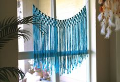 This teal blue boho macrame curtain is a great addition to any space.  This is a made-to-order, custom handwoven piece. Send me a message with