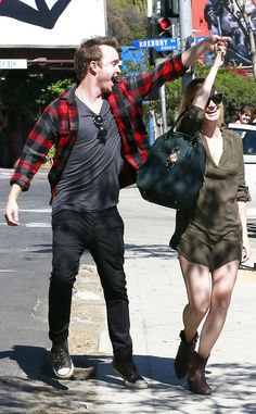 they're so freaking cute. love that outfit of hers - olive green dress, brown booties, black leather satchel.