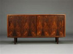 Fantastic Danish rosewood credenza. Made in Denmark by Aage Hundevad.Amazing grain pattern. Very good condition. Would delight any mid century enthusiast.Dimensions: 54\