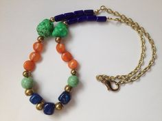 Navy orange and turquoise gold statement by WiredJewelrybyJenna, $22.50