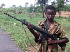 Boy with a gun Sierra Leone