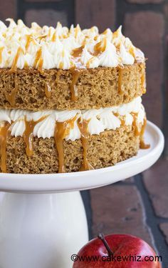 This EASY SPICED APPLESAUCE CAKE with caramel sauce and cream cheese frosting is super soft and moist. Perfect old fashioned cake recipe for Fall and Thanksgiving parties! From cakewhiz.com