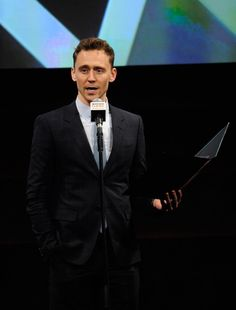Tom Hiddleston on stage presenting the Empire Legend Award at Jameson Empire Awards 2013 (x)