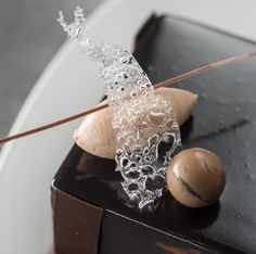 When simplicity meets elegance. Valrhona ILLANKA 63% crémeux, Chocolate sponge cake, Vanilla cream and Caramel crunch by Pastry Chef Peter Scarola