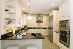 Spacious custom kitchen with ample storage and granite breakfast bar