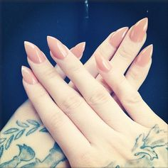 I normally don't like pointed nails, but they suit her.