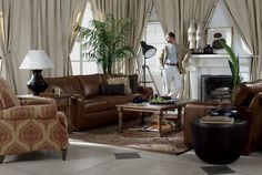 Ethan Allen - 2 leather couch layout with recliner, coffee table, and side table.