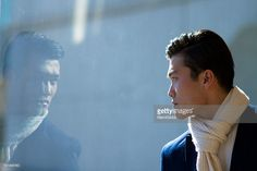 Young man looking reflected in window#http://www.gettyimages.com/galleries/photographers/mamigibbs