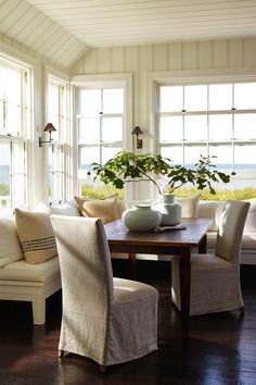Sawyer Berson - dining rooms - tongue and groove walls, L shaped banquette, L shaped dining banquette, white dining banquette, L shaped sini...