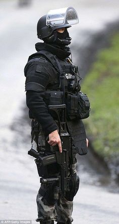 A member of GIGN, French police special forces, is pictured in Corcy, near Villers-Cotterets, north-east of Paris Military Police, Military Weapons, Military Soldier, Military Spouse, Swat Police, Police Cars, Tactical Armor, Military Special Forces, Army Wallpaper