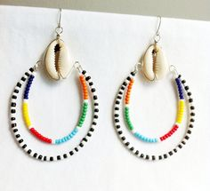 These multi-colored hoops are inspired by the Maasai people of Kenya, Afrika. The Cowrie Shell is at the center of these earrings which is