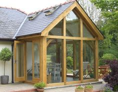 This is a lovely oak-framed conservatory. Nice to see a modern looking conservatory design with a wooden frame. This is a lovely oak-framed conservatory. Nice to see a modern looking conservatory design with a wooden frame. Small Conservatory, Conservatory Extension, Small Sunroom, Cottage Extension, Conservatory Design, Garage Extension, Small Terrace, Bungalow Extensions, Garden Room Extensions