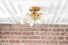 Edison Bulb Ceiling Lamp - Flush Mount - Mid Century Modern - Brass Ceiling Fixture - Globe Lamp  Greetings! My name is Jay Harrison and Im the lighting designer here at Mod Creation. I lead a small team of talented craftsmen with over 15 years of experience in handcrafting lamps. I