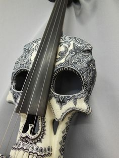 Don't Be Afraid To Learn To Play Guitar! Do you enjoy playing music? Maybe you aren't sure how to play guitar. You can play guitar as long as you're willing to practice and use these tips. Art Et Design, Electric Violin, Electric Guitars, Skull And Bones, Memento Mori, Day Of The Dead, Skull Art, Skull Decor, Music Stuff