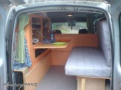 Kitchen + flip up bed in van