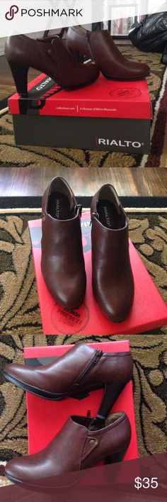 Beautiful brown/cognac leather material boots NWT! NWT! In box never worn extremely comfortable. Heel 3 1/2 in. Can't say enough about the beauty and comfort of these! Brand: Rialto. Style; Phiona Rialto Shoes Ankle Boots & Booties