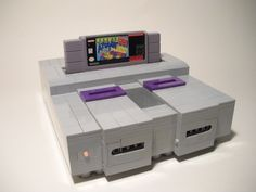 https://flic.kr/s/aHsjxE6AiM | Lego Super Nintendo (SNES) | My best creation a 1:1 model of a Super Nintendo with functioning eject lever and power light. It can also fit in a REAL Super Nintendo cartridge!