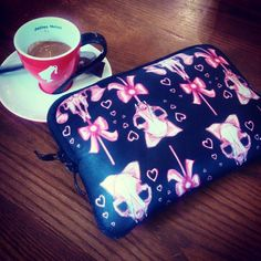 In the café with using my CANDY SKULLS iPad mini pouch.  AVAILABLE NOW! GET IT HERE:  www.etsy.com/shop/Vodumstore  @vodumstore  #candy #skulls #wallet #ipad #bag #pouch #bones #pagan #PINK #witchcraft #Witches #witch #lolita #lolipop #kawaii #harajuku...
