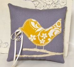 ring bearer pillow...this but with the two countries with string coming from them to tie the rings!