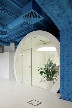 saturated blue surrounds bright whites in this media agencys office advertising agency office szukaj