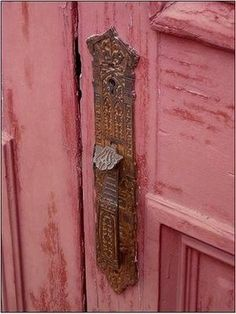 I love the pealing pink paint and the drop dead door gorgeous latch.
