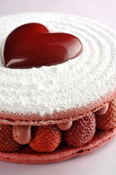 This sharing dessert is packed with strawberries and strawberry mousse sandwiched in a giant strawberry macaron. Köstliche Desserts, Plated Desserts, Delicious Desserts, Christophe Roussel, Yummy Treats, Sweet Treats, Desserts Valentinstag, Macaron Cake, Valentines Day Desserts