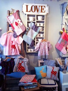 Craft display. Incredible array of applique kids' clothes too :)