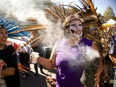 traditional aztec dancers in mexico at el día de los muertos (day of the dead), rooted in an aztec festival thousands of years old, dedicated to the worship of the goddess mictecacihuatl (queen of the underworld, lady of the dead)
