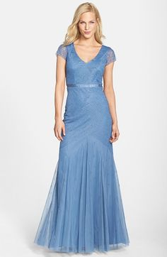 Free shipping and returns on Adrianna Papell Beaded Mesh Gown at Nordstrom.com. The gauzy overlay of a romantic floor-sweeping gown is alight in beaded coverage with more shimmer concentrated around the cap-sleeve bodice. Silky tonal ribbon defines the slender waistline.