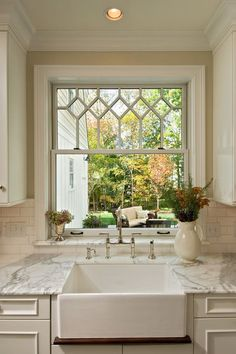 Love everything about this...the window, sink, subway tile, marble counter....