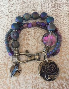 Bronze bracelet with blues, lilacs and large round multi color crystal