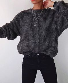 I like the edginess of this outfit, and the tight jeans, with looser sweater.  #silverjewelry