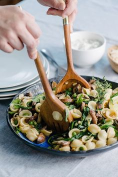 Spring pasta primavera with peas, mushrooms and spinach.