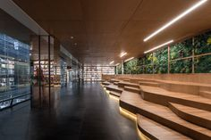 Hubei Foreign Language Bookstore, China by Wutopia Lab - 谷德设计网 Chinese Architecture, Architecture Design, Bookstore Design, Catwalk Design, Tiered Seating, Kids Cafe, Street Trees, Lobby Interior, Complex Systems