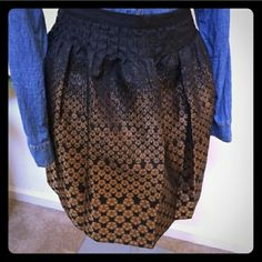 Black and gold bubble skirt Reposh, still has tags attached. this skirt is so so cute and I love it but sadly it does not fit me. It does go with pretty much anything tho! Size large no Holds no trades price is lowest Skirts