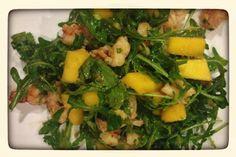 A tasty healthy salad w shrimp, mango, avocado over arugula