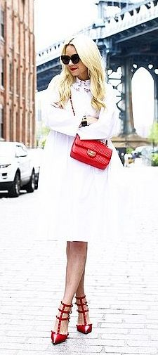A white dress with red accessories