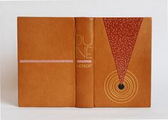 Dune by Frank Herbert bound by Erin Fletcher // bound in tan goatskin with terra-cotta embroidered onlay, dark brown tooled onlay, gold tooled concentric circles, title and author tooled on spine, blind tooled light pink onlays