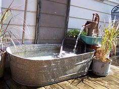 Water feature-I did something similar but used a 100 gallon Rubbermaid tub, metal is toxic to fish. If you want to add fish, you can line the tub with a rubber liner to make it safe for them. Pool Fountain, Garden Fountains, Outdoor Fountains, Garden Ponds, Koi Ponds, Dog Water Fountain, Fountain Design, Water Pond, Bath Water