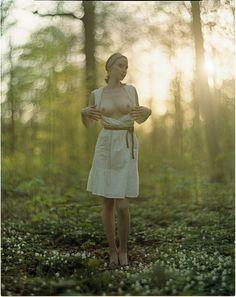 Girl in the flowers by Radoslaw Pujan
