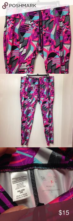 DANSKIN NOW GEOMETRIC PRINT LEGGINGS Size 2X or 20 Like new pre-owned condition geometric print leggings by DANSKIN NOW. Worn and laundered 1x! Size women's plus 2X or 20. Material: 88% polyester, 12% spandex. True to size! Extra wide waistband. Colors: pink, purple, light gray, black, dark gray and turquoise blue. Danskin Now Pants Leggings