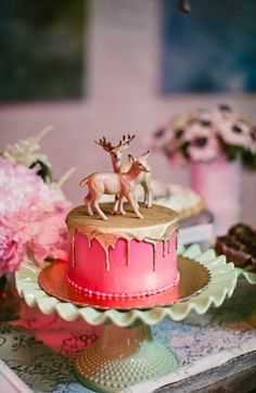 perfect! love the gold. and i dont like the idea of most cake toppers. i wouldn't put deer but some kind of animal... :)