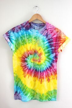 Bright rainbow tie-dyed 100% cotton t-shirt. Please note: Each tie-dyed tee is hand dyed and slightly unique. Washing instructions: Machine wash inside out in very cold water, dry normally. Slight fad