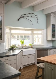 This is perfect, perfect sink and window configuration! Also like the wall color: Palladian Blue by Benjamin Moore