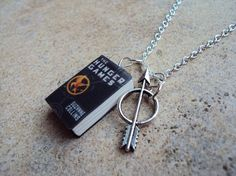 MOVIE SPECIAL HungerGames Necklace with Book Charm and Arrow Charm. $11.99, via Etsy.