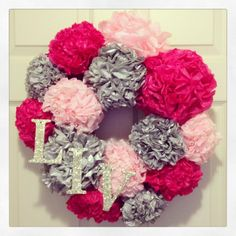 """DIY Paper Pom Pom Wreath! Make it """"Love"""" and would be an adorable Valentine's wreath"""