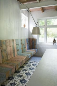 great seating along one wall with cushions
