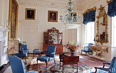 Upholstered in a custom-woven silk damask and positioned on a mid-18th-century Axminster carpet, the mahogany chairs and settee in the Blue Drawing Room were supplied by Chippendale in 1759